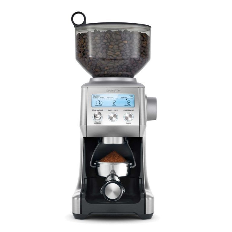 The Breville Smart Grinder Pro coffee grinder. Loaded with coffee beans and a ground filled portafilter.
