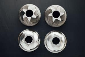 burrs from a disassembled coffee bean grinder