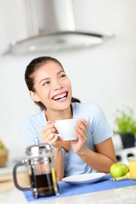 Woman enjoying a nice French Press Coffee